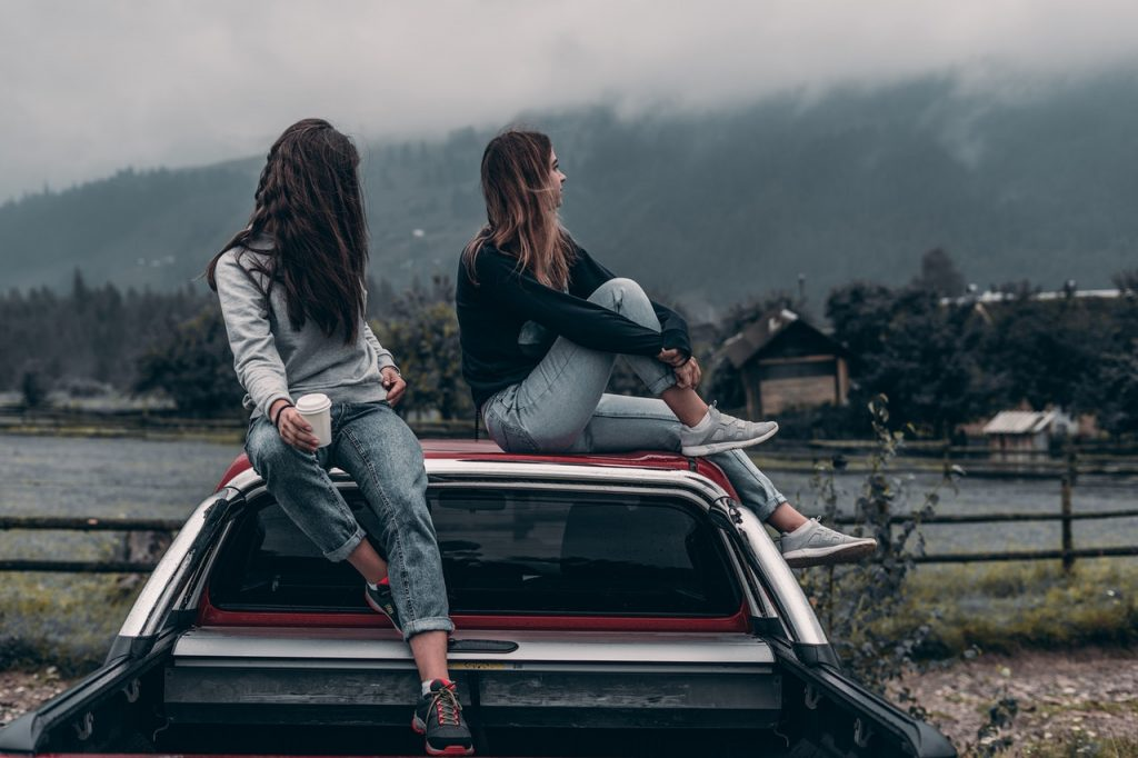 Girls on top of a car