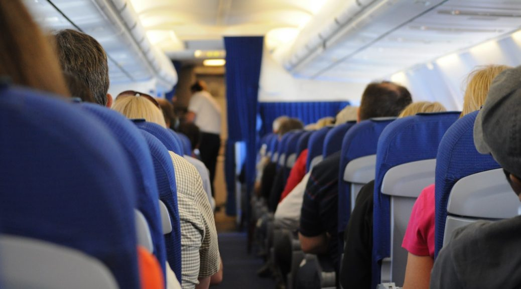 people sitting on a plane and issues